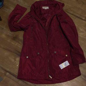 Red Michael Kors rain coat
